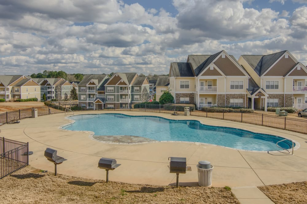 Pool and Barbecue area at Apartments at the Venue in Valley, AL