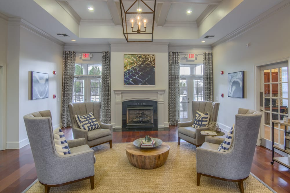 Open community lounging area with fireplace at Apartments at the Venue in Valley, AL