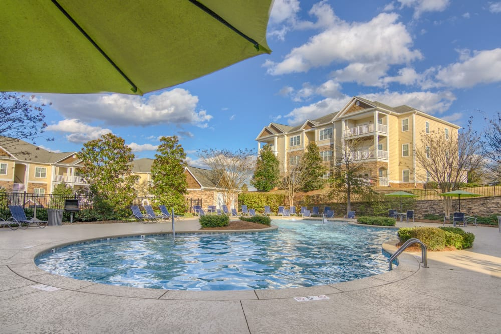View of apartment homes surrounding the outdoor pool at Apartments at the Venue in Valley, AL