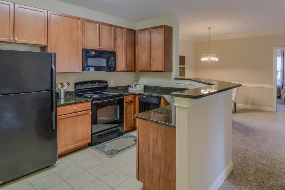 Kitchen with wrap-around bar at Apartments at the Venue in Valley, AL