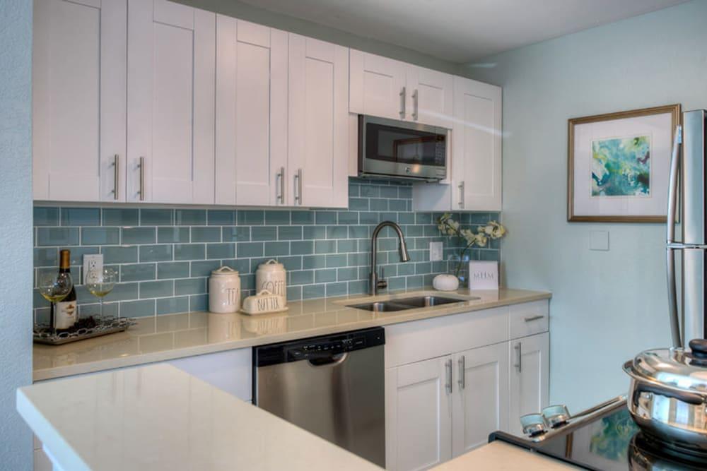 White cupboards in kitchen at El Mar in North Redington Beach, Florida