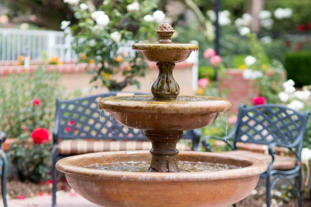 Outdoor seating next to the fountain at Gables of Ojai in Ojai, California