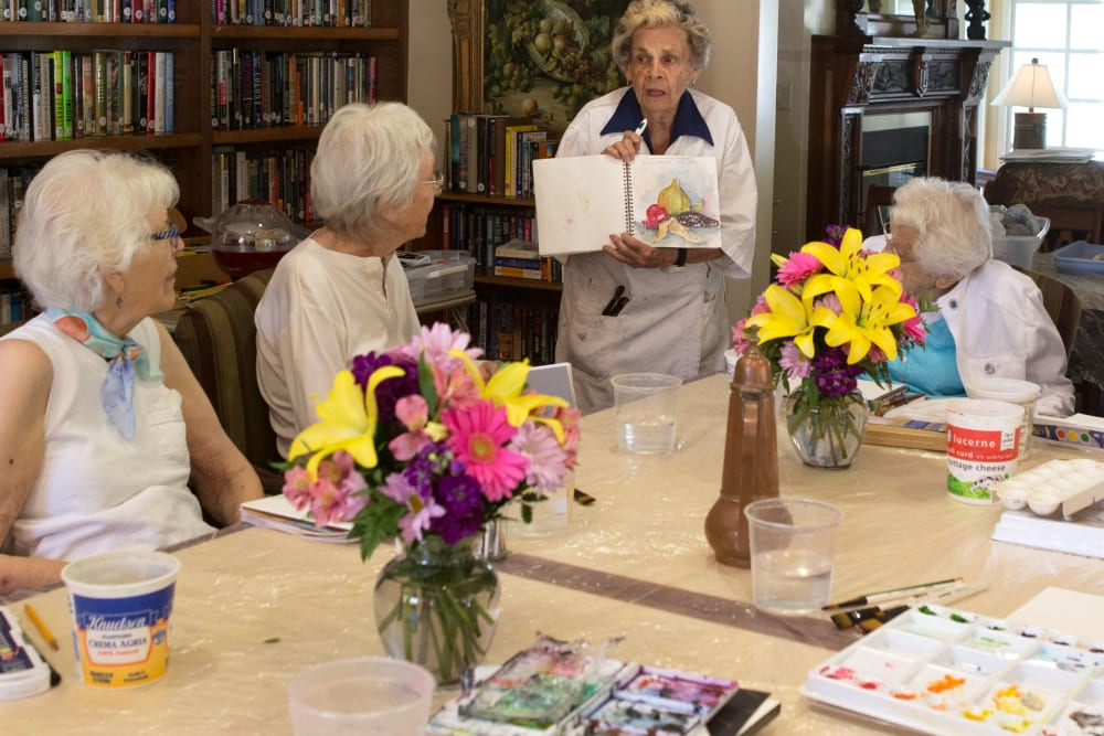 A resident displaying her artwork at Gables of Ojai in Ojai, California