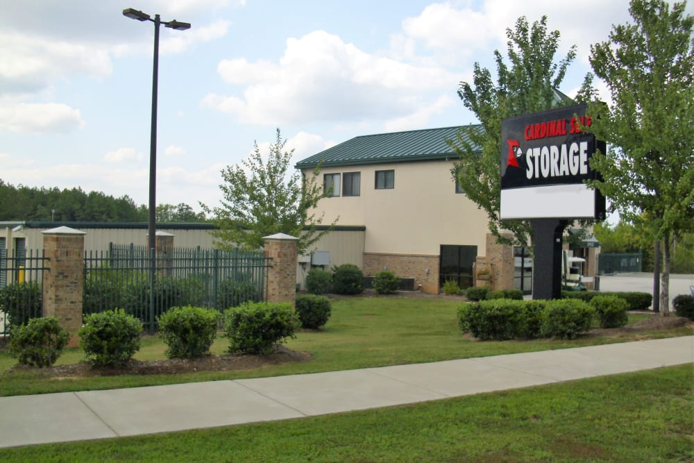 Company sign in front of Cardinal Self Storage - North Durham in Durham, North Carolina