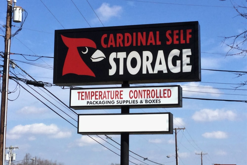 Large sign in front of Cardinal Self Storage - Burlington in Burlington, North Carolina