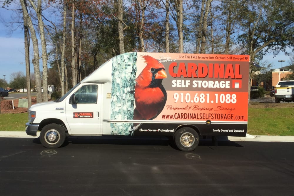Moving truck with large logo from Cardinal Self Storage - Wilmington in Wilmington, North Carolina