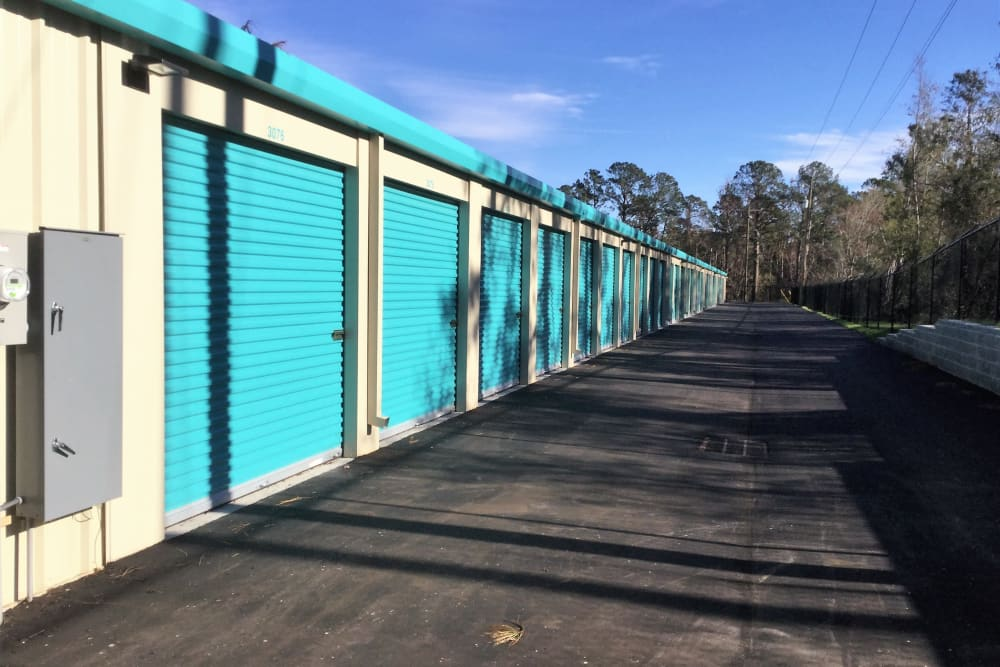 Outdoor storage units in the middle of the day at Cardinal Self Storage - Wilmington in Wilmington, North Carolina