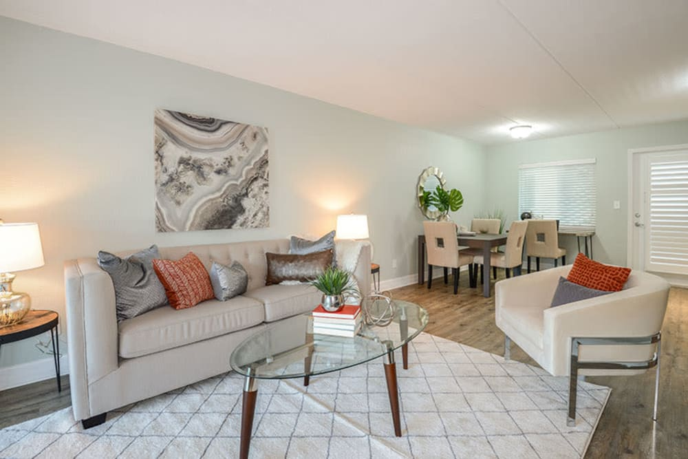Couch in living room of model home at Sailpointe Apartment Homes in South Pasadena, Florida
