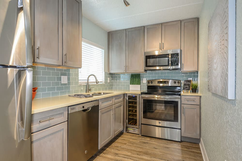Kitchen in model home in South Pasadena, Florida at Sailpointe Apartment Homes