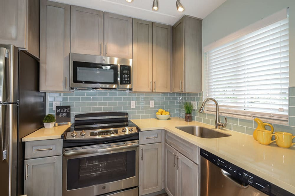 Stylish kitchen in model home at Sailpointe Apartment Homes in South Pasadena, Florida