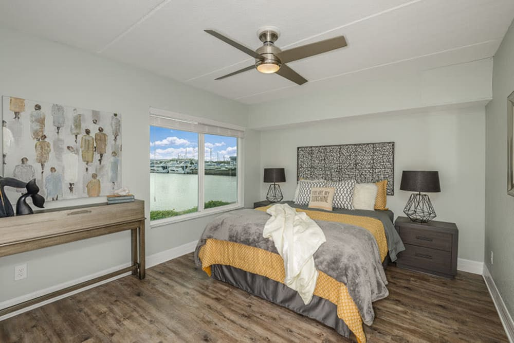 Master bedroom in model home at Sailpointe Apartment Homes in South Pasadena, Florida