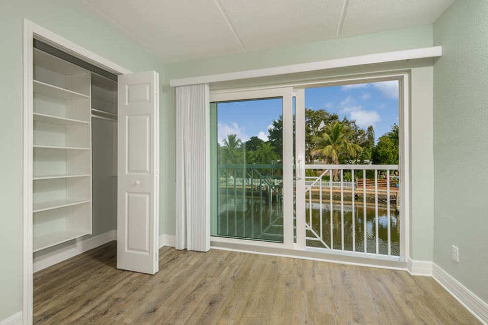 Closet in bedroom and balcony from slider in South Pasadena, Florida at Sailpointe Apartment Homes