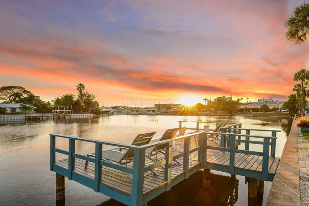 Sunset over pier at Sailpointe Apartment Homes in South Pasadena, Florida