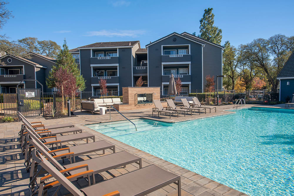 Lounge by the pool at Slate Creek Apartments in Roseville, California