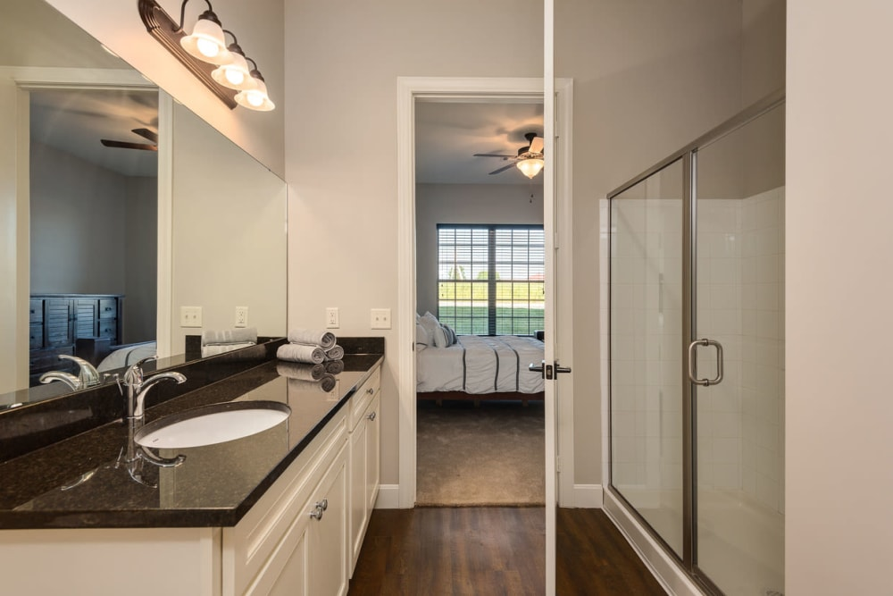 Granite counter tops and a glass shower in the bathroom at Boulders at Overland Park Apartments in Overland Park, Kansas