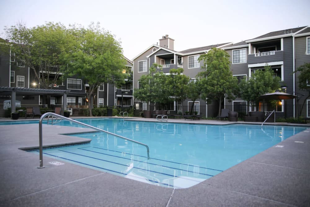 Take a swim in the spacious pool at Slate Creek Apartments in Roseville, California
