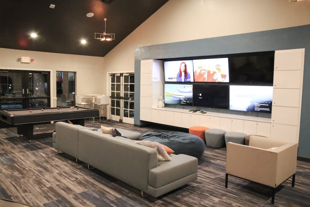 TV's and a pool table for entertainment in the clubhouse at Slate Creek Apartments in Roseville, California