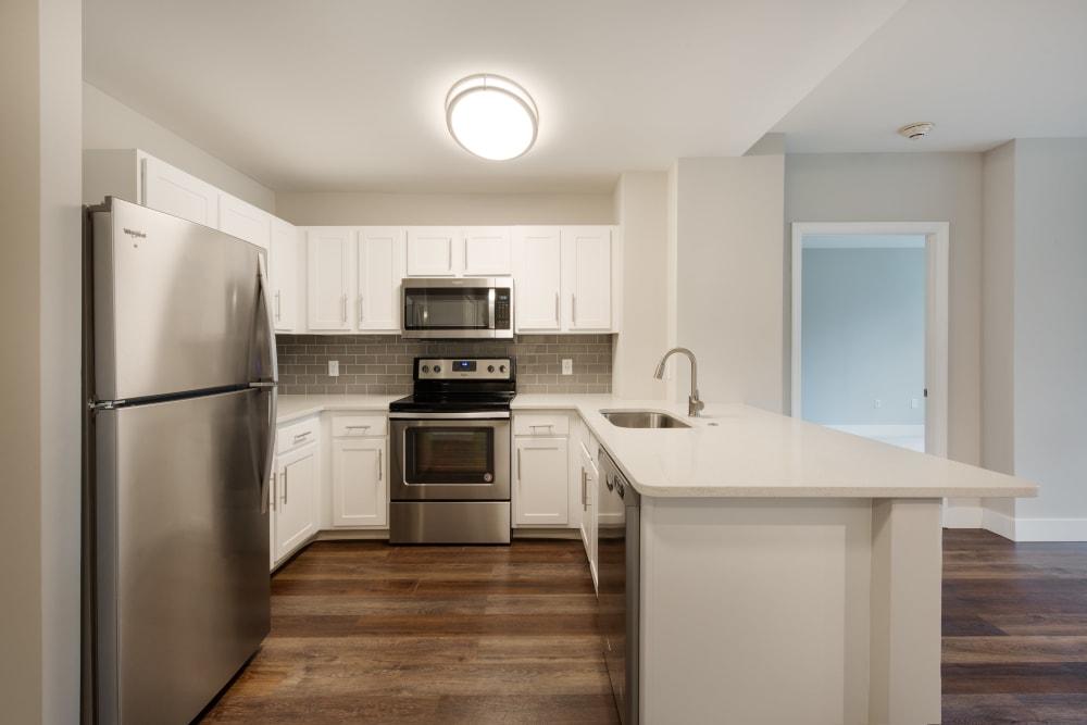 Kitchen with hardwood floors at Kimball Towers at Burlington in Burlington, Massachusetts