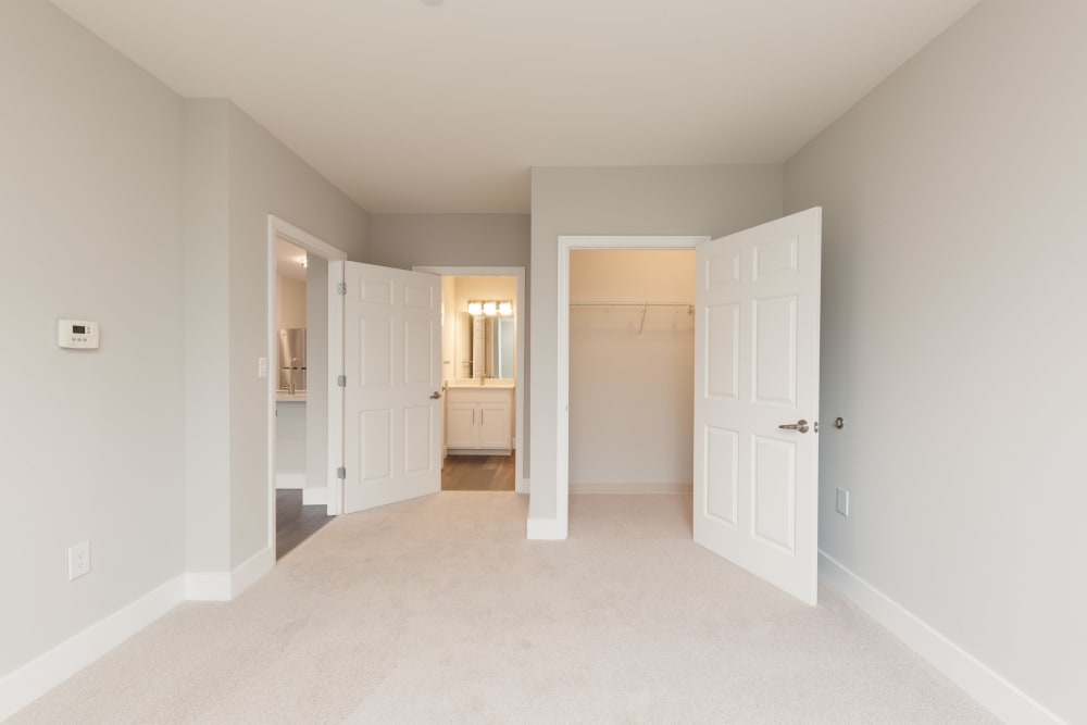 Bedroom with walk in closet and bathroom available at Kimball Towers at Burlington in Burlington, Massachusetts