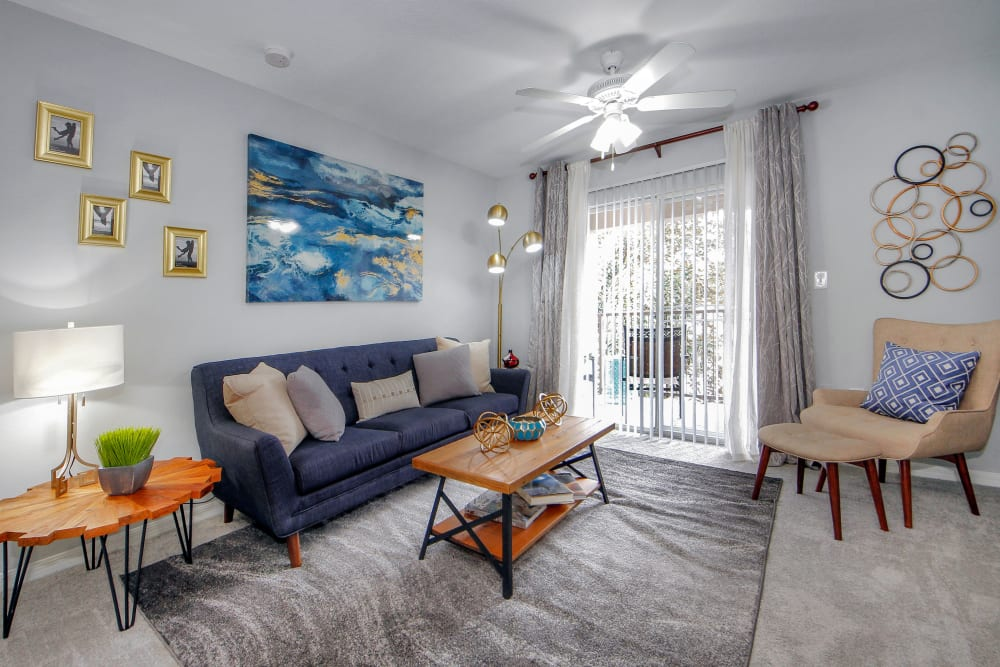 Bright living room with modern decor  at Legends Winter Springs in Winter Springs, Florida