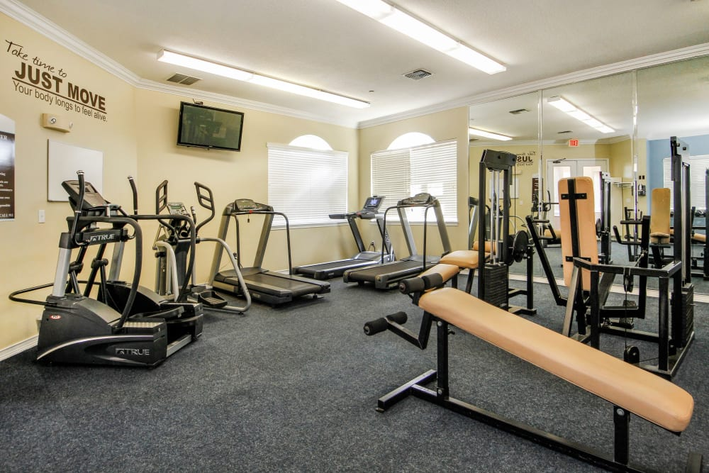 Fitness center with a tv  at Legends Winter Springs in Winter Springs, Florida