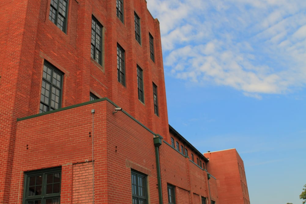 Building view with blue sky at The Lofts Of Greenville in Greenville, South Carolina
