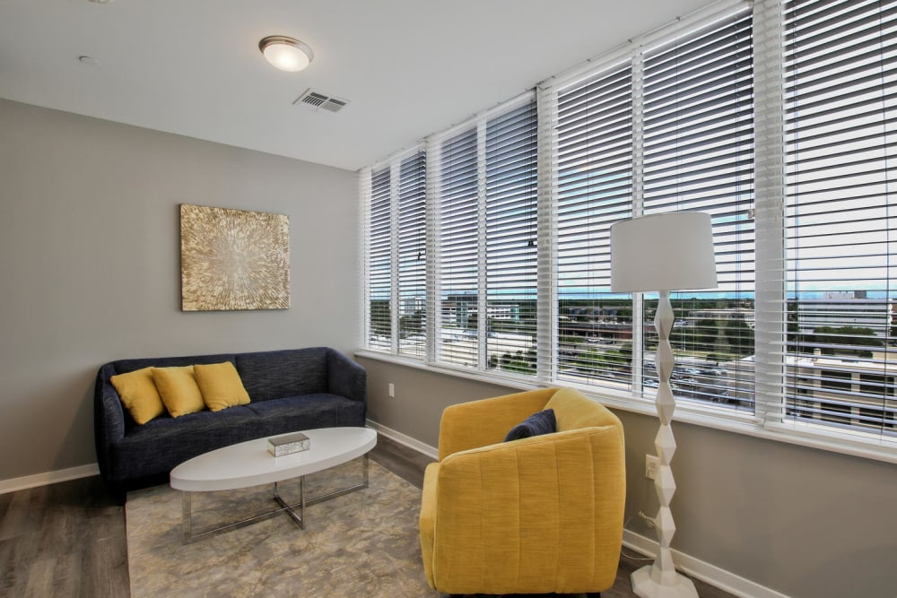 Model living room with yellow accents at Colorado Derby Lofts in Wichita, Kansas