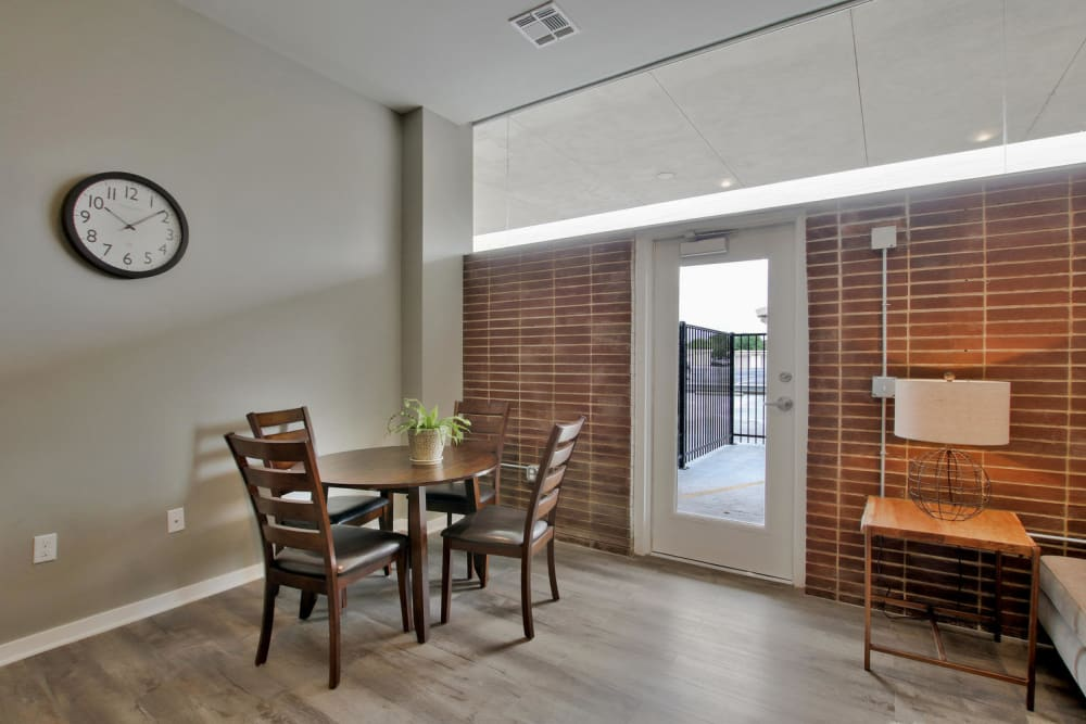 Living room with exposed brick at Colorado Derby Lofts in Wichita, Kansas