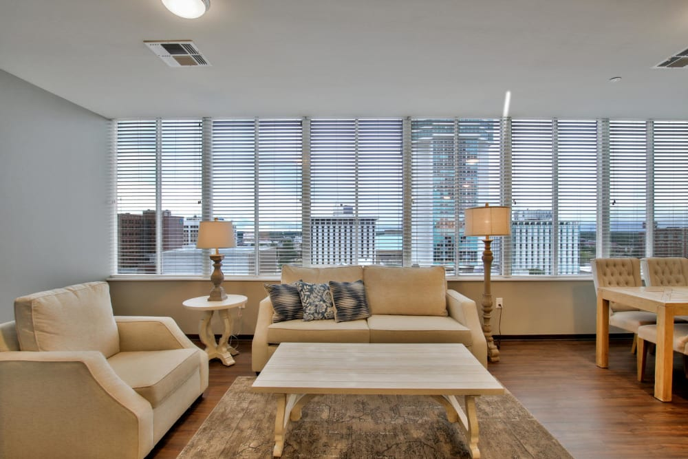 Living room model with yellow accents at Colorado Derby Lofts in Wichita, Kansas