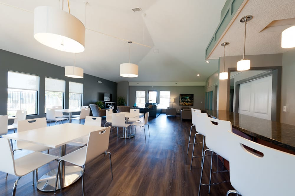 A clubhouse with lovely wood flooring at Pointe West Apartment Homes in West Des Moines, Iowa