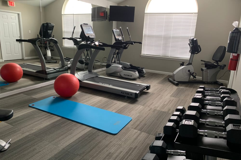 A fitness center with space for yoga at Timber Ridge in Fredericksburg, Virginia