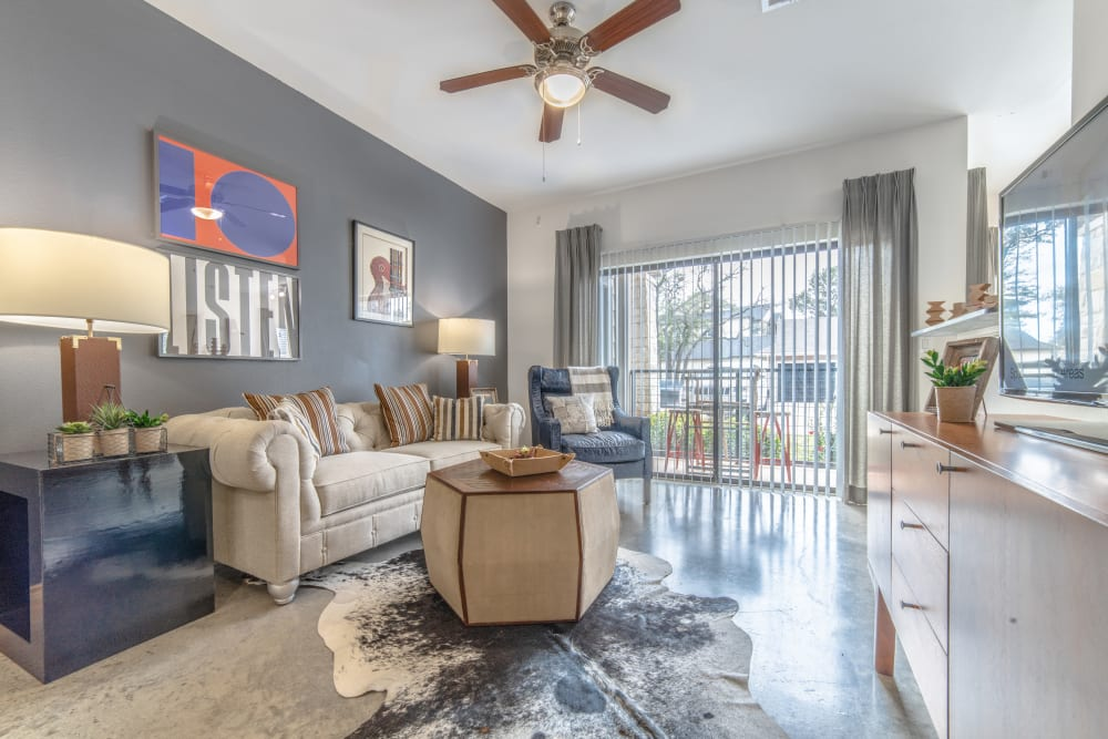 Decorated living room in model home at Ethos Apartments in Austin, Texas