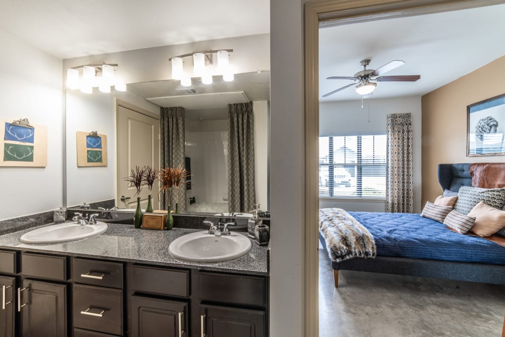 Master bathroom and bedroom at Ethos Apartments in Austin, Texas