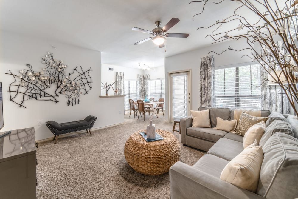 Furnished living room in model home at Ethos Apartments in Austin, Texas