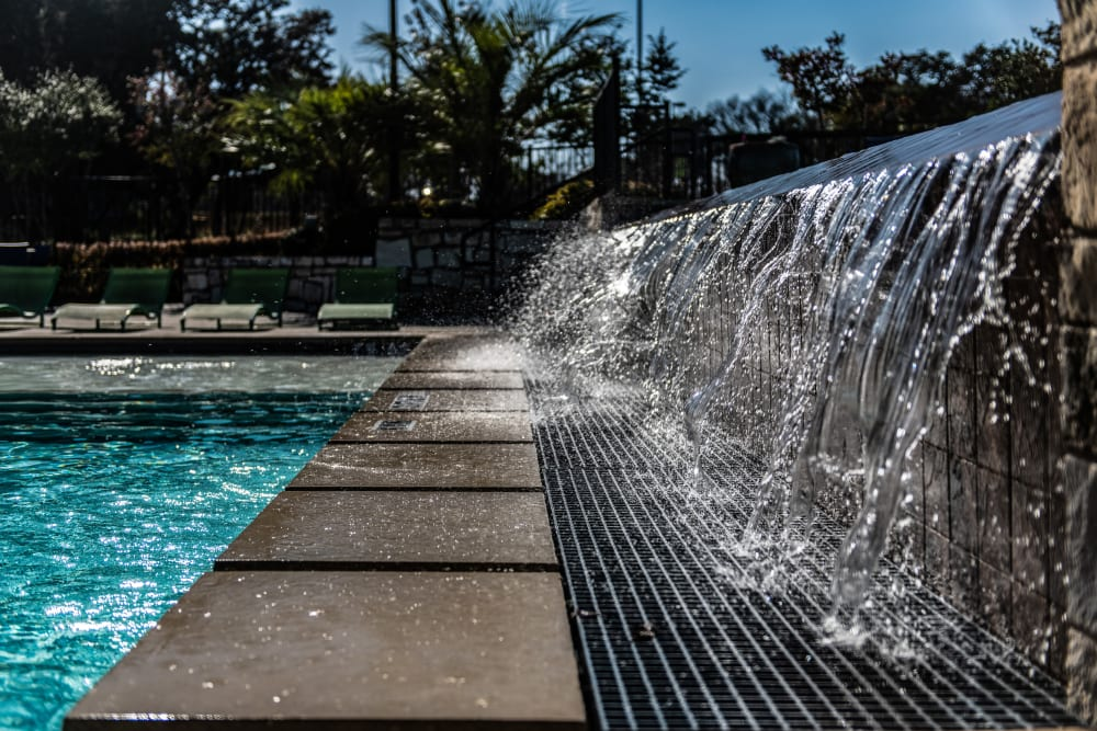 Water features next to the pool in Austin, Texas at Ethos Apartments