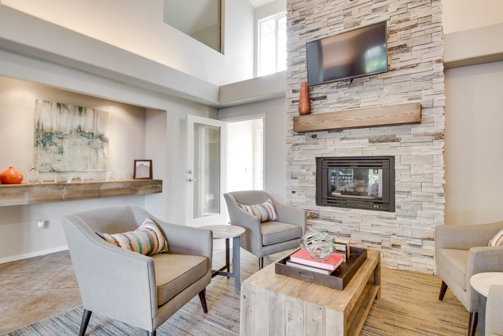 Fireplace in luxurious clubhouse at Copperstone Apartment Homes in Everett, WA