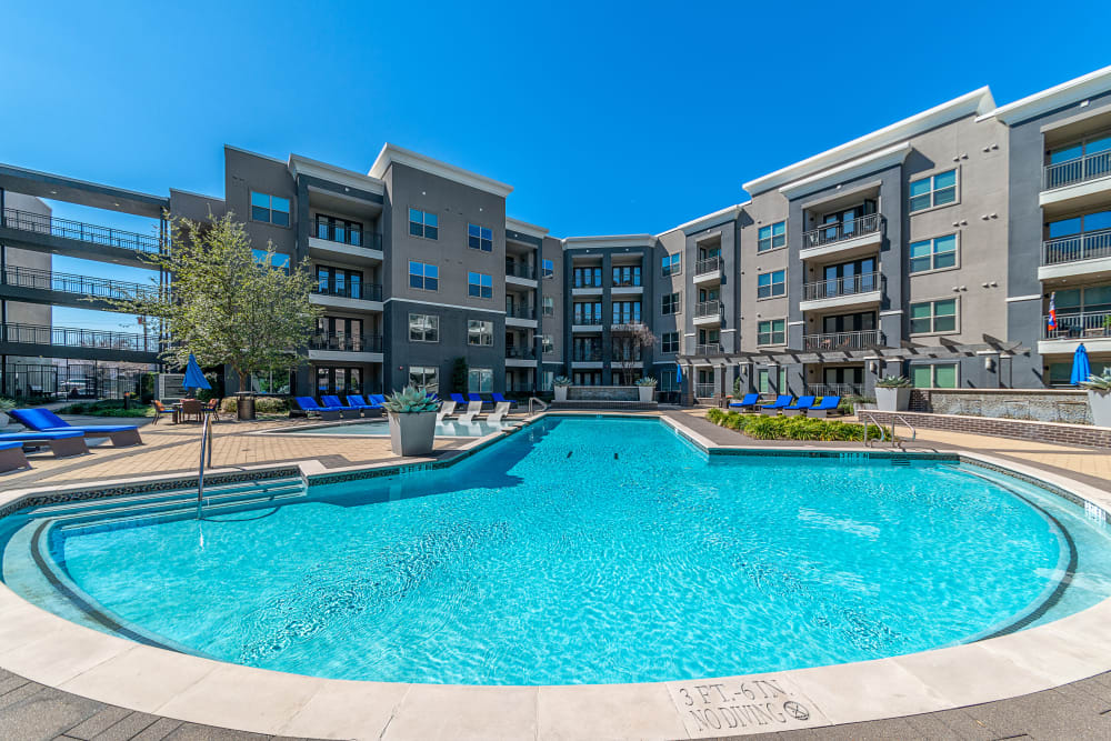 Sparkling swimming pool on a beautiful day at Axis at Wycliff in Dallas, Texas