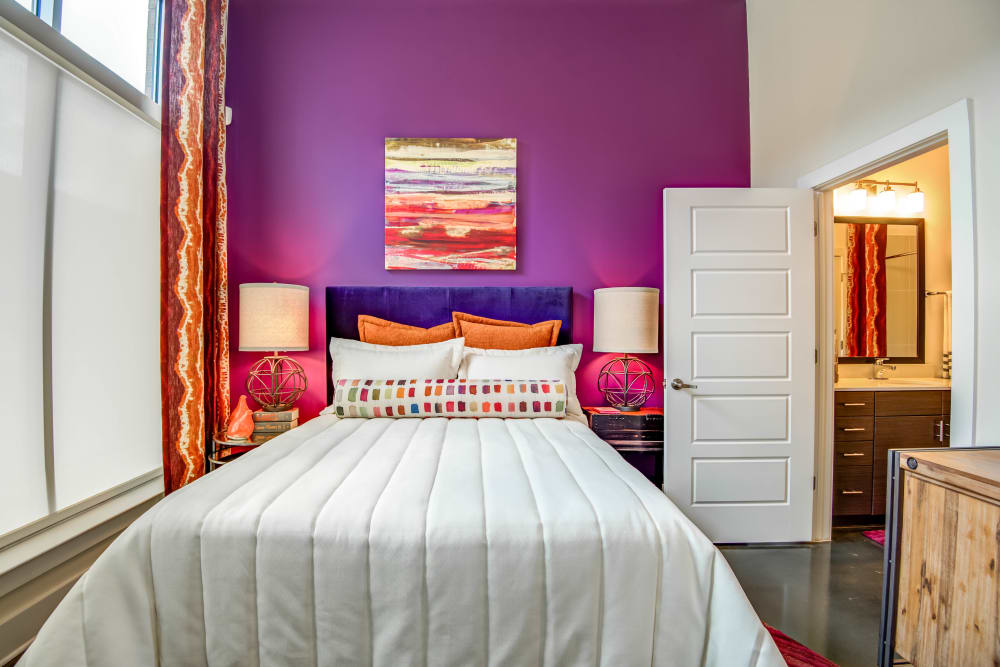 Bright colorful master bedroom at Mercury NoDa in Charlotte, North Carolina
