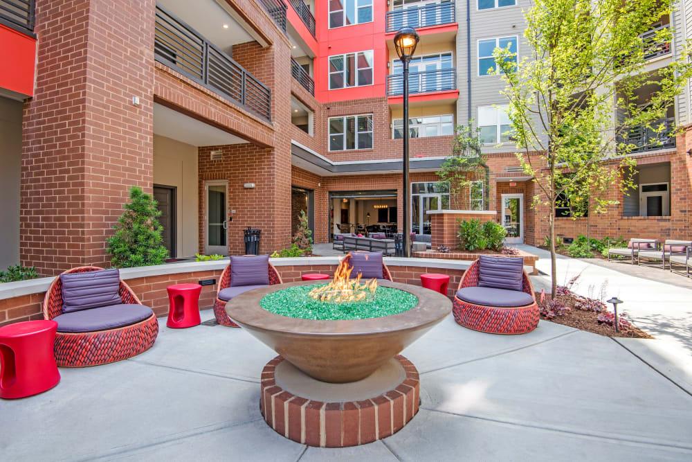 Red patio seating at Mercury NoDa in Charlotte, North Carolina