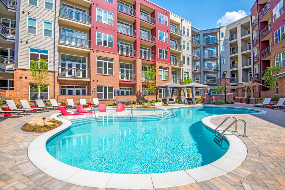 Outdoor pool on a sunny day at Mercury NoDa in Charlotte, North Carolina