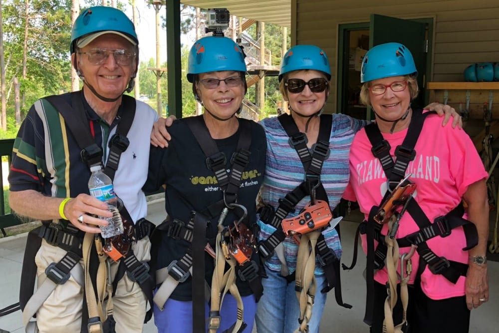 Residents from Touchmark in the West Hills in Portland, Oregon preparing to zipline