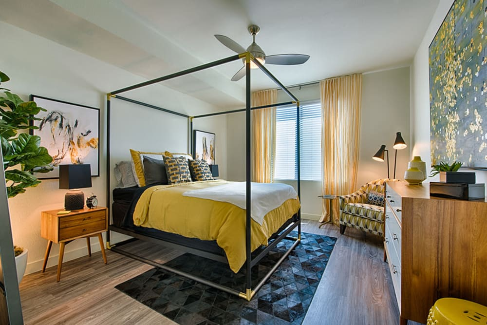 Bedroom with yellow accents at The TOMSCOT in Scottsdale, Arizona