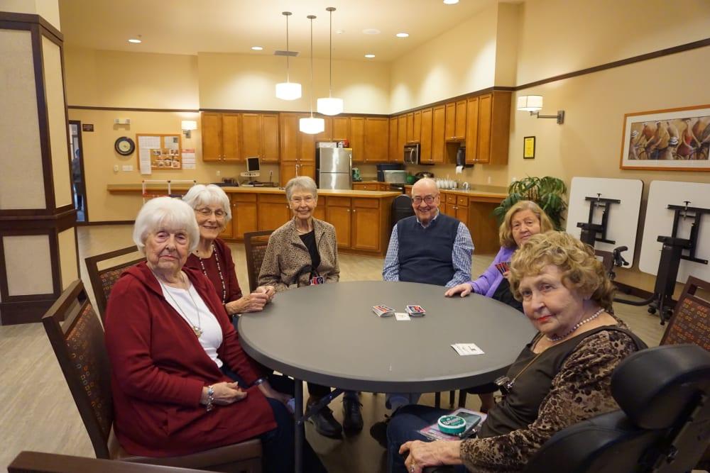 Residents sitting around an activity table in Kirkland, WA