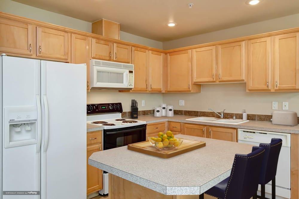 Kitchen At Aravia Apartments In Tacoma WA