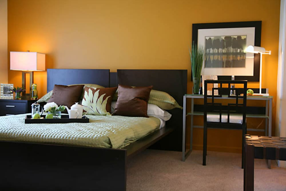 Furnished large master bedroom at President Madison Apartments in Madison Heights, Michigan