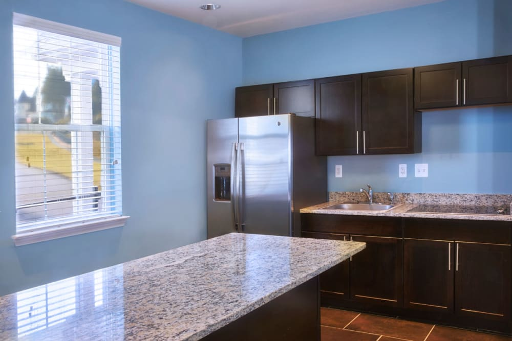 Large island in middle of kitchen at Lexington Village Apartments in Madison Heights, Michigan