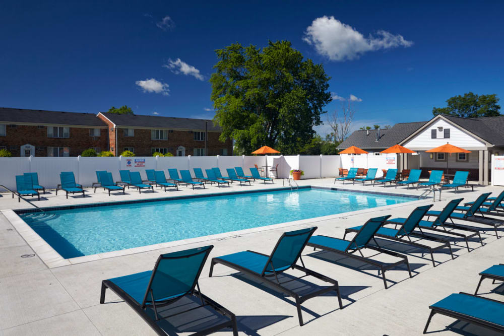 Lounge chairs to tan on in Madison Heights, Michigan at Lexington Village Apartments