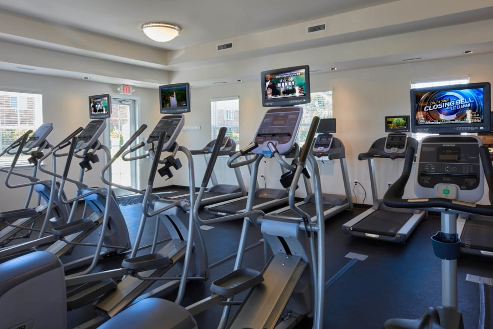Exercise equipment in the fitness center at Lexington Village Apartments in Madison Heights, Michigan
