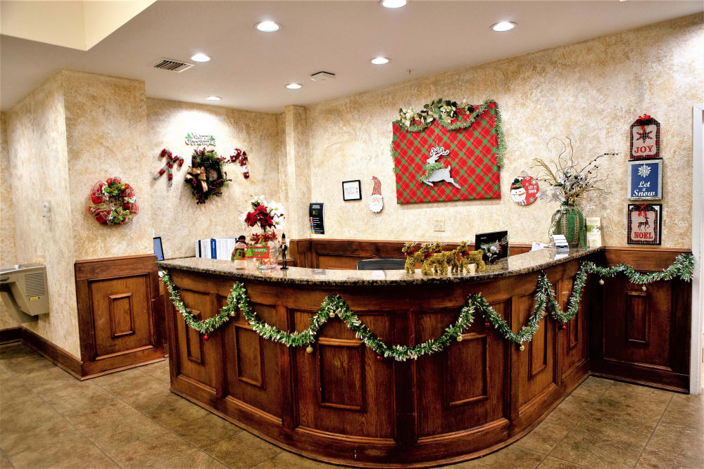 The front desk with holiday decorations at The Grande in Brooksville, Florida