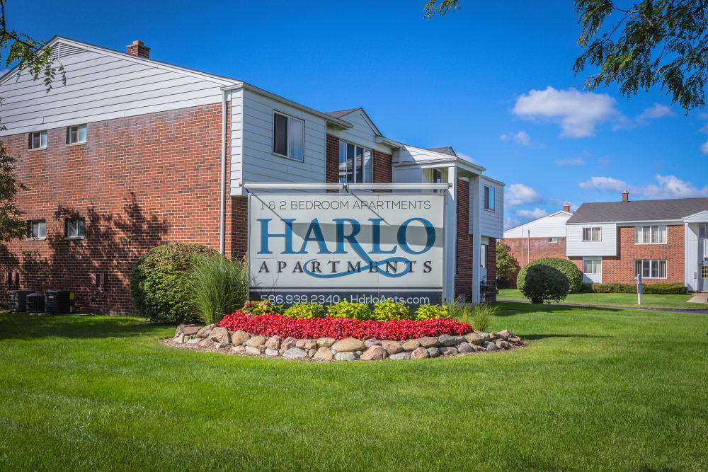Harlo Apartments sign in front of apartments in Warren, Michigan